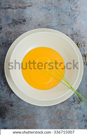 View from above to the delicious healthy pumpkin cream soup - stock photo