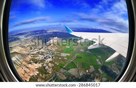 View from airplane window on fields and mountains,  Cappadocia ,Turkey - stock photo