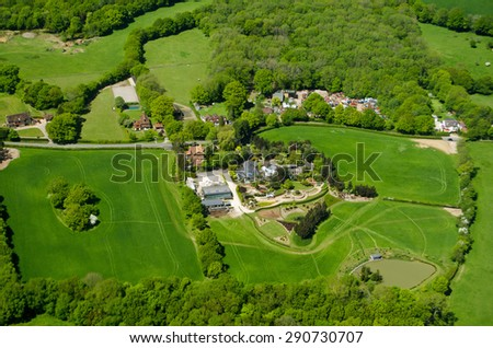 View from an airplane of expensive homes and farmland at Russ Hill in Surrey, close to Gatwick Airport in countryside. - stock photo