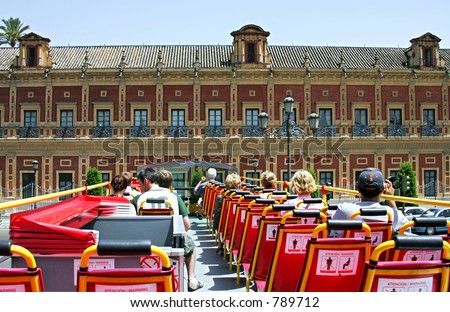 View from back of top deck on open roofed tour bus in Seville, Spain - stock photo