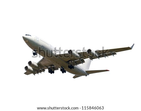 view from below on the white jet passenger aircraft with the gear against the blue sky - stock photo