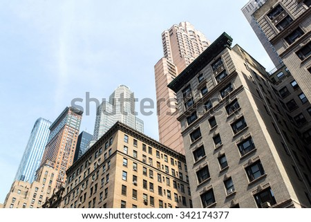 view from bottom of some buildings in the midtown of manhattan in new-york city - stock photo