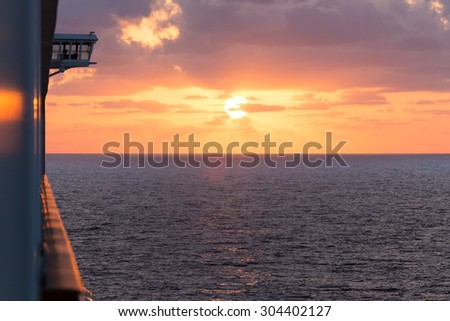 View from cruiser with sunset in the background - stock photo