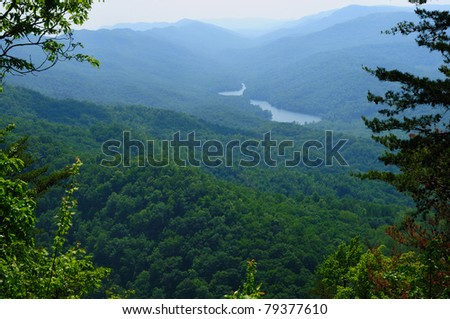 View from Cumberland Gap of Fern Lake Tennessee and the place (foreground ridge) where three states meet: Virginia, Tennessee, and Kentucky - stock photo