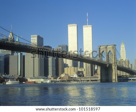 View from East River of the Brooklyn Bridge and skyline in New York City, New York - stock photo