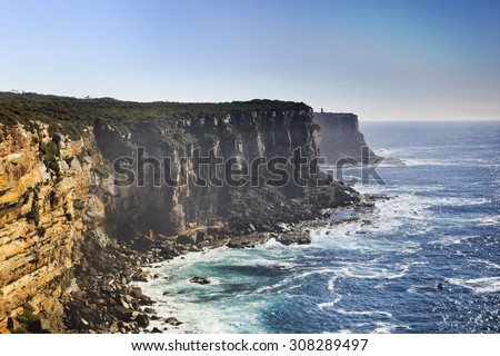 view from elevated lookout from north head in Sydney, Australia, towards rugged rocky coast on a sunny summer day - stock photo
