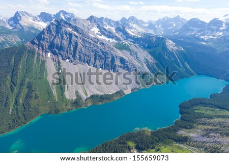 view from helicopter at beautiful lake in canadian rocky mountains - stock photo