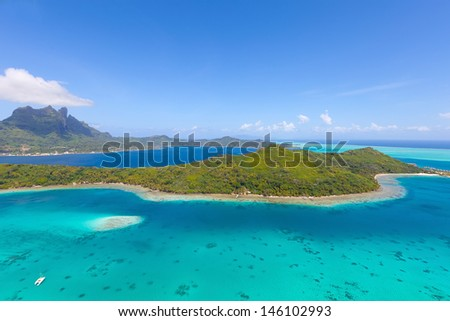 view from helicopter at mount otemanu at bora bora island, french polynesia - stock photo