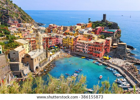 View from high hill of Vernazza houses and blue sea, Cinque Terre national park, Liguria, Italy - stock photo