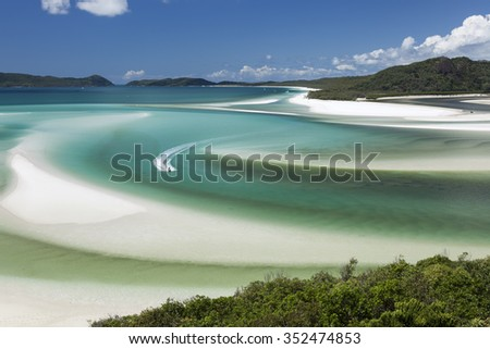 View from Hill Inlet of a wave runner in the waters of Whitsunday Island in Queensland, Australia - stock photo