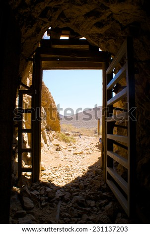 View from inside a gold mine in the wilds of California's Mojave Desert. - stock photo