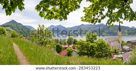view from lookout point to schliersee lake and village with church, bavarian alps, - stock photo