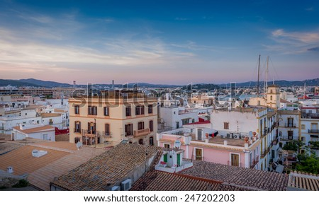 View from medieval fortress to popular streets and roofs of Ibiza - stock photo