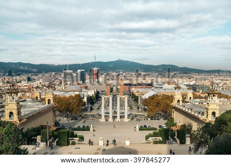 View from Montjuic to Plaza de Espana including the four columns and the venetian towers in Barcelona, Spain - stock photo