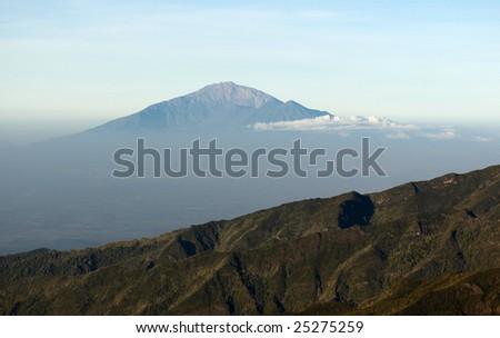 View from mount Kilimanjaro on a mount Meru near Arusha at sunrise. Tanzania. - stock photo