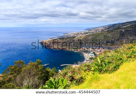 View from Pico do Facho viewpoint over the Machico valley, Airport in the background, Madeira, Portugal - stock photo