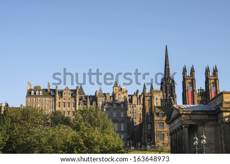 View from Princes Street towards the Royal Mile, showing the exterior of historic Edinburgh buildings - stock photo