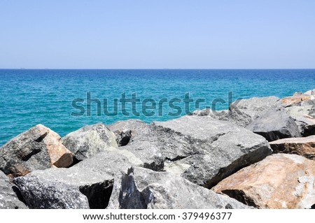 View from rocky groyne at Cottesloe Beach of the turquoise Indian Ocean seascape in Western Australia/Indian Ocean Waters: View from Groyne/Cottesloe Beach, Western Australia - stock photo