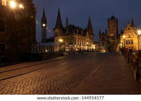 View from Saint Michael's Bridge towards the towers of Ghent : the Saint Nicholas' church and the Belfry of Ghent.  The tower left is the old Post Office. - stock photo