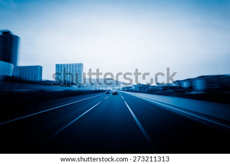 View from Side of Car Going Around Corner, Blurred Motion - stock photo
