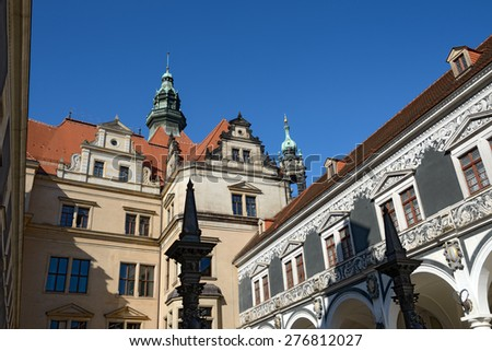 View from Stables Courtyard (Stallhof) toward roof and turrets of George Gate of Dresden Castle, Saxony, Germany. - stock photo
