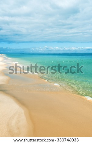 View from Tangalooma Island beach during the day with an overcast sky - stock photo