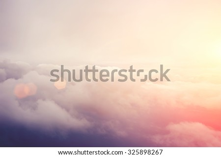View from the airplane of a cumulus puffy white clouds with sunlight background with copy space for your text message or promotional content, advertising background - stock photo