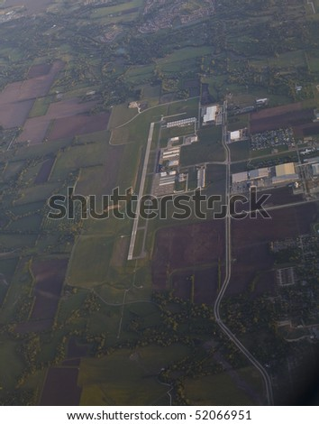View from the airplane's window of airport - stock photo