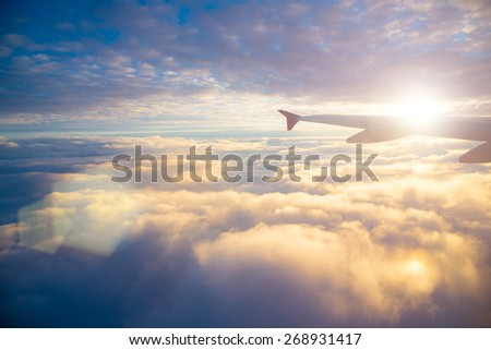 view from the airplane window at the sky - stock photo