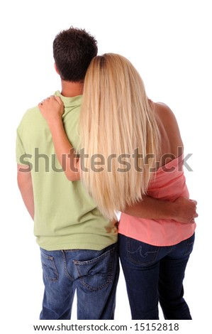 View from the back of couple embracing isolated over a white background - stock photo