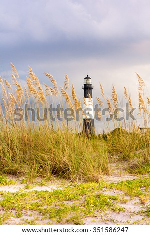 View from the beach of the light house located in the Tybee Island, Georgia, US. - stock photo