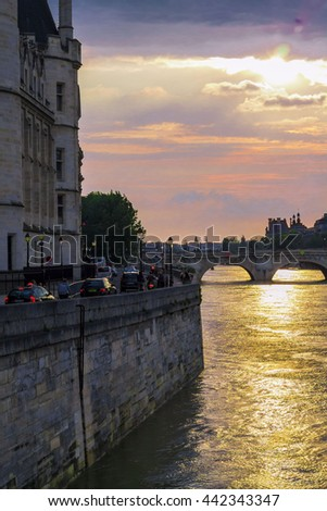 View from the bridge to beautiful sunset in the center of Paris - stock photo