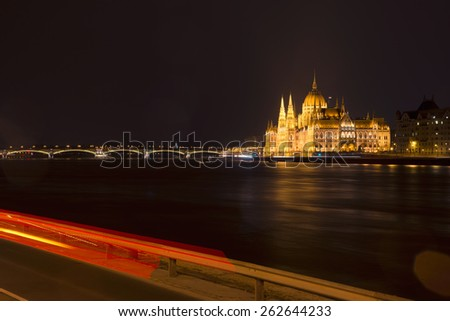 view from the Buda side of the Hungarian Parliament Building at night in Budapest - stock photo