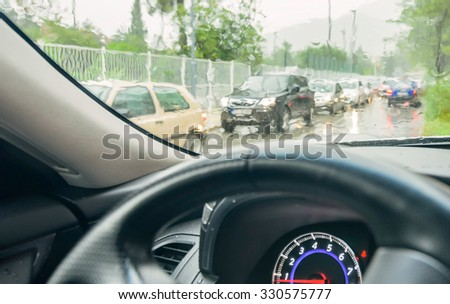 View from the car glass on the rainy day - stock photo