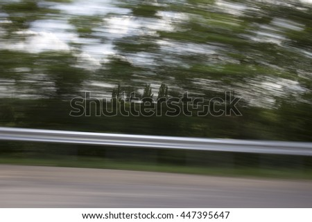 View from the car window. Landscape photographed while driving. - stock photo