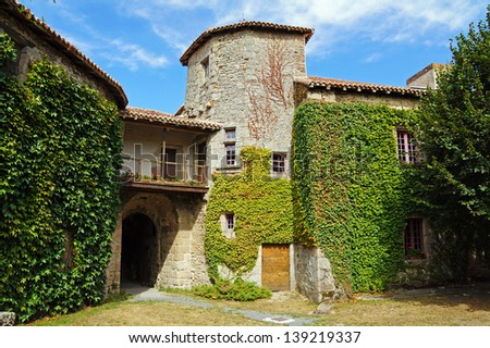 View from the courtyard in the medieval castle of Mortemart, Limousin, France - stock photo