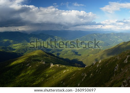 View from the hill to the mountain village. Summer landscape. Carpathians, Ukraine, Europe - stock photo
