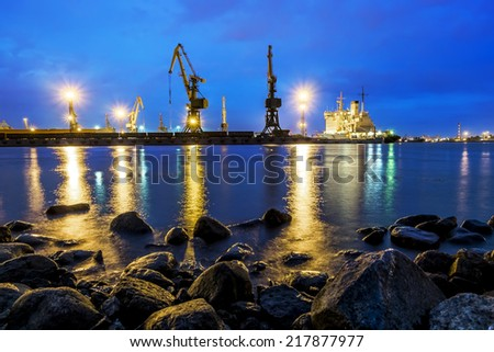 View from the Kanonerskiy island on the loading in the sea port of St. Petersburg, with night illumination August 10, 2014 - stock photo
