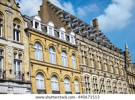 View from the main square of characteristic Flemish high pitch roofs in Ypres (Ieper), Belgium - stock photo