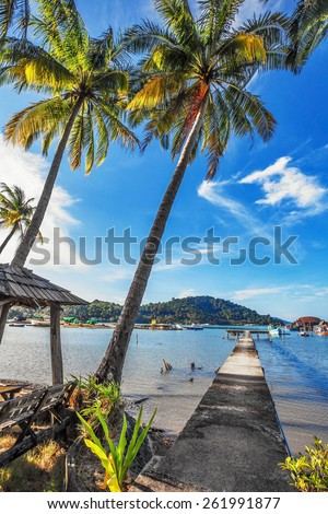 View from the pier on the sea at tropical beach  - stock photo