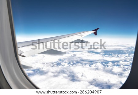 view from the plane, blue sky in the window - stock photo