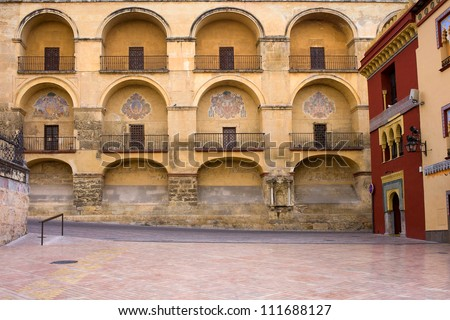 View from the Plaza del Triunfo on the Mezquita Cathedral historic facade in Cordoba, Spain. - stock photo