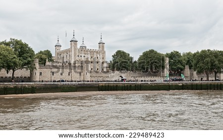 View from the River Thames of the famous Tower of London in London, England - stock photo