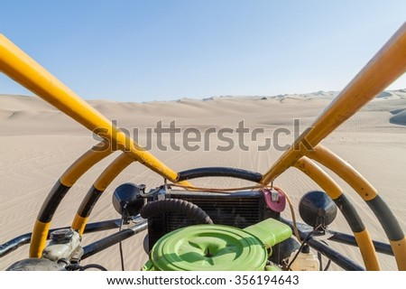 View from the sand dune buggy in the dunes of Huacachina desert, Peru. - stock photo