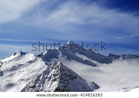 View from the ski slope on Mount Elbrus at sun evening. Caucasus Mountains. - stock photo