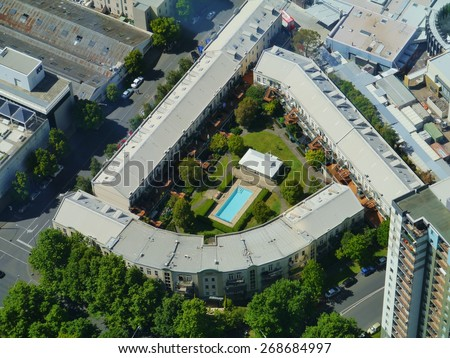 View from the skydeck of the Eureka tower of a courtyard with a swimmin pool in Melbourne in Victoria in Australia - stock photo