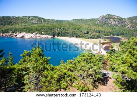 View from the top of a mountain in Acadia National Park looking at white beach lagoon - stock photo