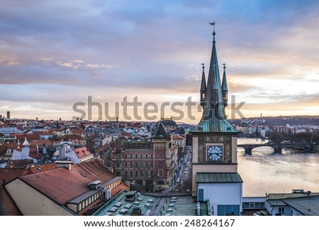 View from the top of the Charles bridge tower over the old town center of Prague at the sunset time in winter - stock photo