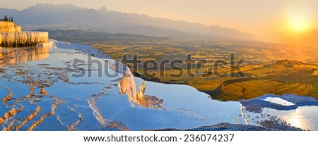 View from the top point on panorama with fields on horizon and hot springs in  foreground. - stock photo