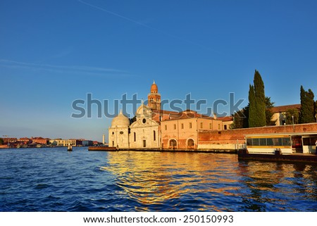 View from the Venice lagoon on the church of San Michele in Isola and on the famous cemetery island of San Michele at sunset, Murano island on background. Venice, Italy  - stock photo